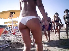 Firm ass beauty in a sexy white bikini bottom