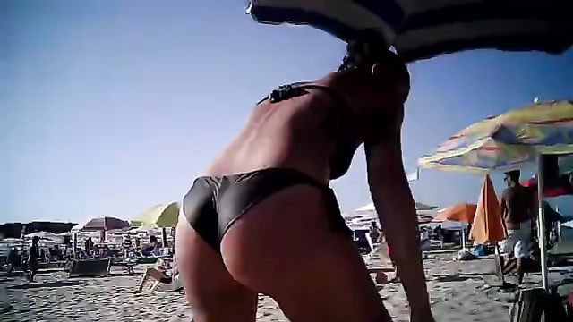 Great female ass in black bikini bottoms