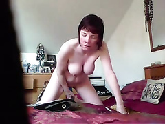 Large-breasted wife rides on a big dildo