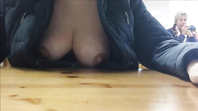 Dining with my wife as she flashes her large breasts