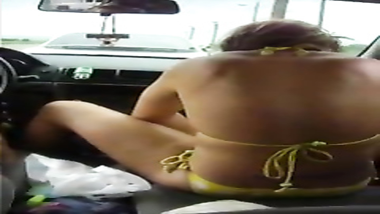 Lovely hitchhiker in the yellow bikini plays with her tampon