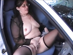 British wife poses with her large tits out in front of a car