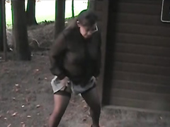 Slutty outfit on a wife urinating in the woods