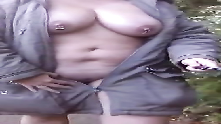 Chubby Russian amateur flashes her big tits outdoors