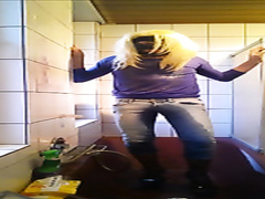 Masked crossdresser pisses in his jeans and wanks