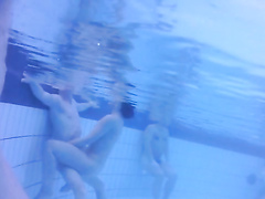 Nudists in the pool get filmed underwater