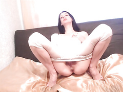 Pissing her pants and rubbing her pretty pussy