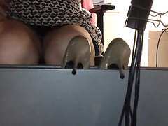 Glamorous secretary has her crotch filmed underneath the table
