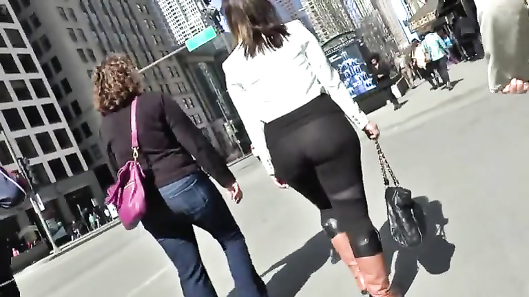 Big butt woman walks the city streets in spandex